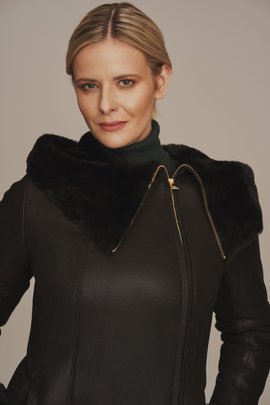 Women's black sheepskin coat with a hood